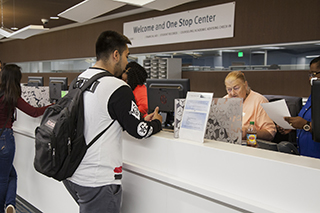 Photo of students registering for classes at the Welcome and One Stop Center