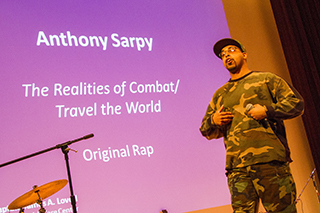 Photo of veteran Anthony Sharpy rapping at 2016 veterans festival