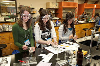 Photo of high-school girls doing a fun chemistry experiment