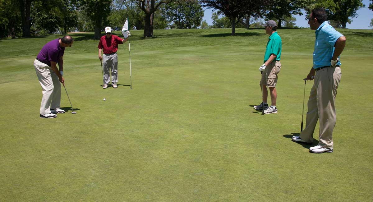 Attendees of the Foundation Golf Classic on the green