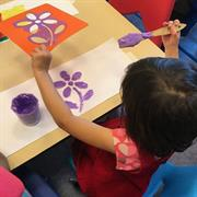 Student at the Learning Center doing a painting activity