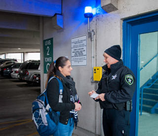 CLC police officer and student in parking garage