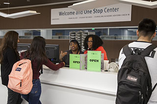 Photo of students registering at the Welcome and One Stop Center